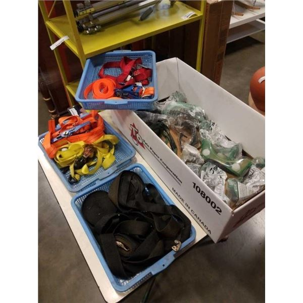 Box of safety goggles and 3 baskets of tie down straps
