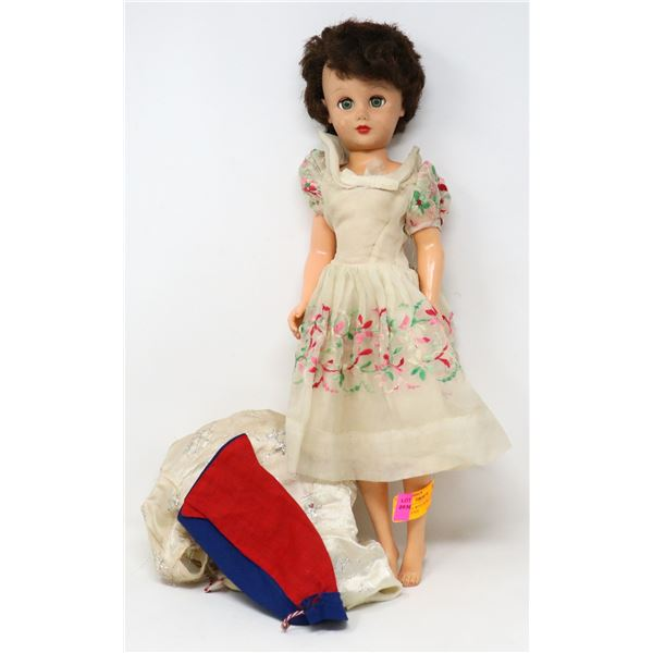 1950S DOLL WITH EXTRA CLOTHING CLOSING EYES