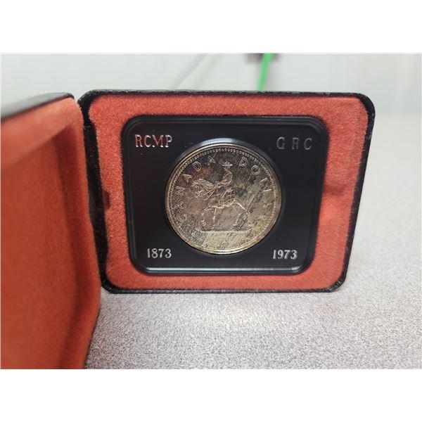 1973 RCMP Centennial Silver  Dollar   (Toned )