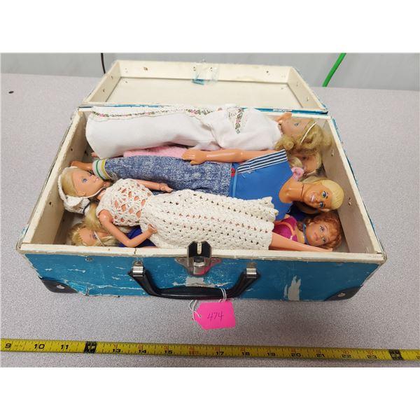 9 older dolls and case