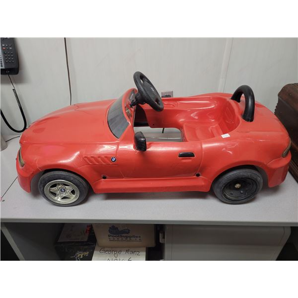 Plastic pedal car (nice condition)