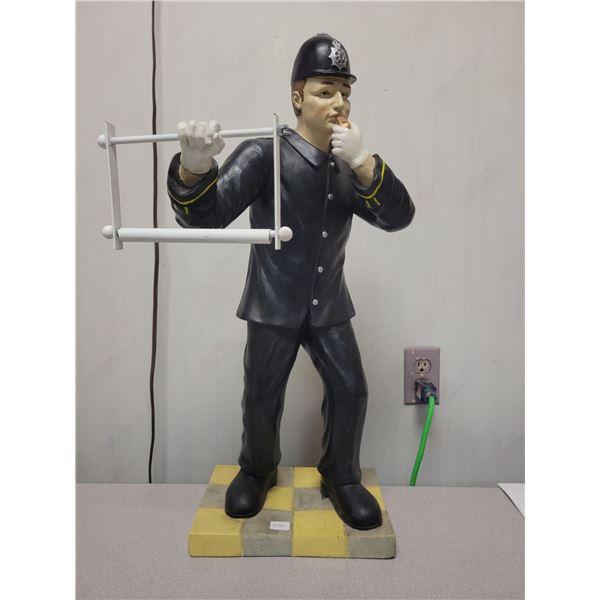 Police man toilet paper holder