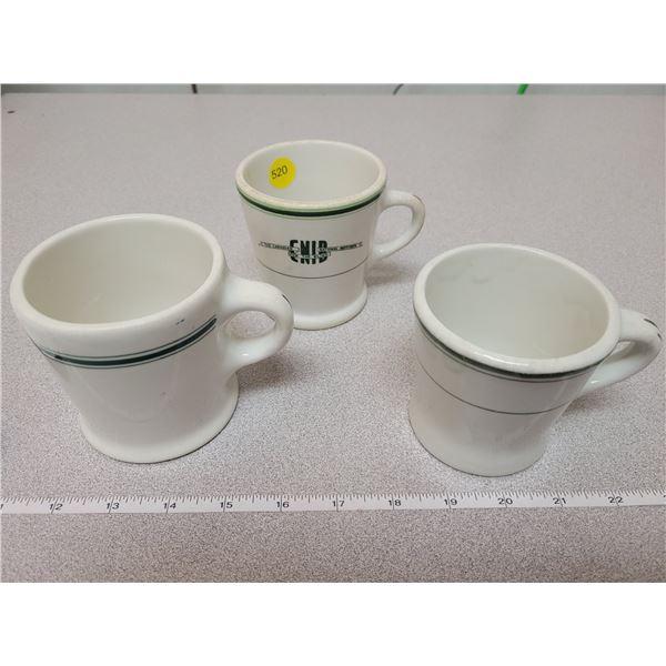 Three green/white restaurant mugs - one marked C.N.I.B.