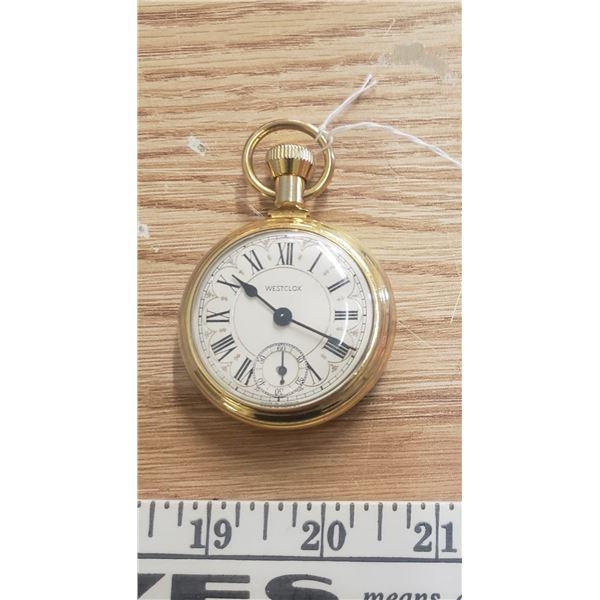 Gold tone pocket watch