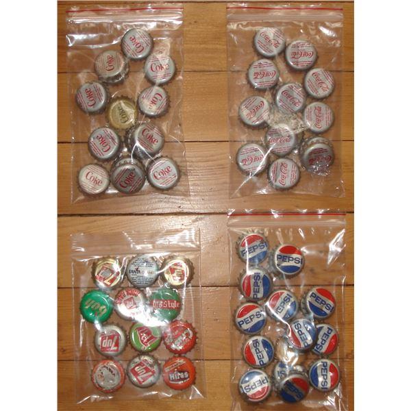 selection of coke / pepsie bottle caps coca cola