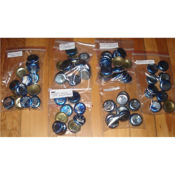 assorted different packs Labatt beer caps