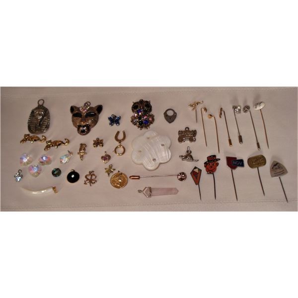 assortment of jewelry pendants, crystals, pins