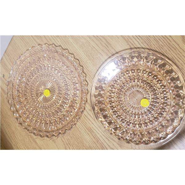 pair of pink depression glass plates