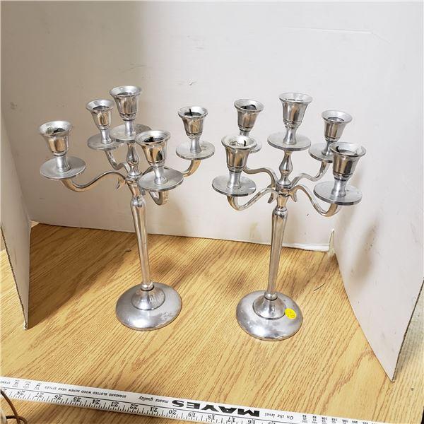 pair of aluminum candle sticks