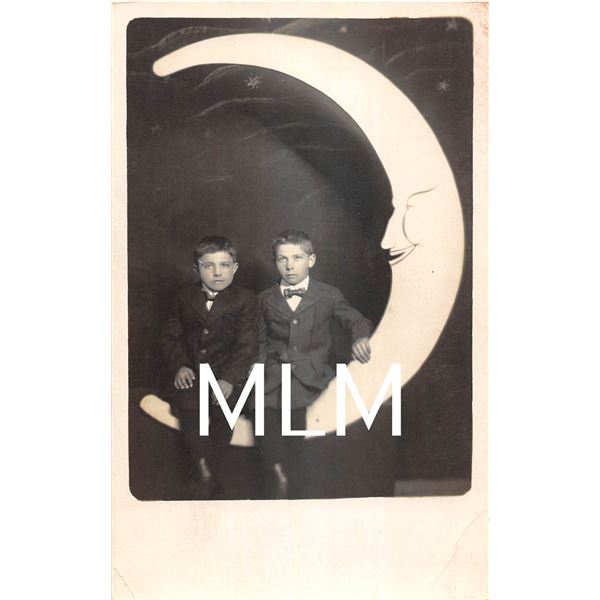 Two Children Sitting on Paper Moon Photo Postcard