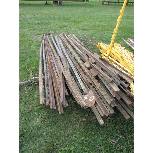 lot of approximately 35 steel fence post various lengths