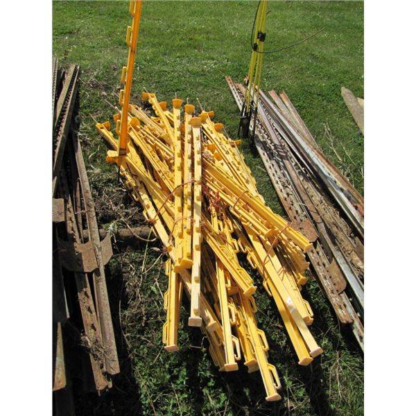 lot of approximately 30 yellow plastic electric fence posts