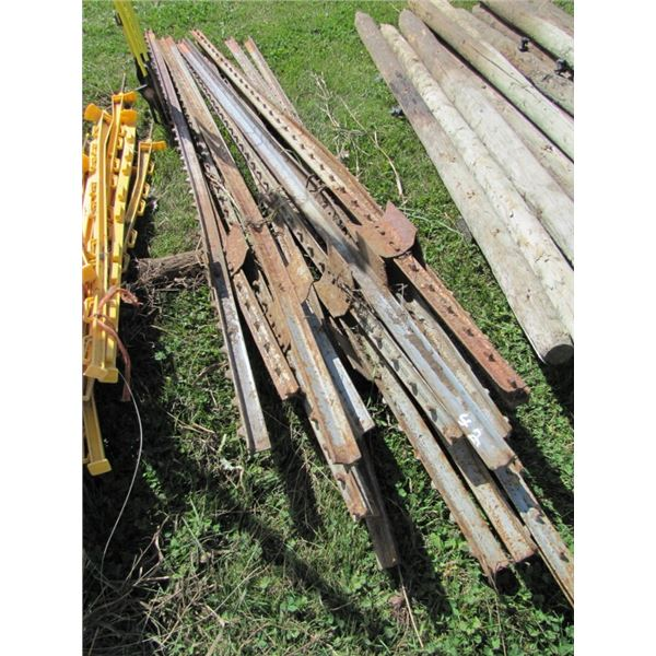 lot of approximately 15 steel fence posts