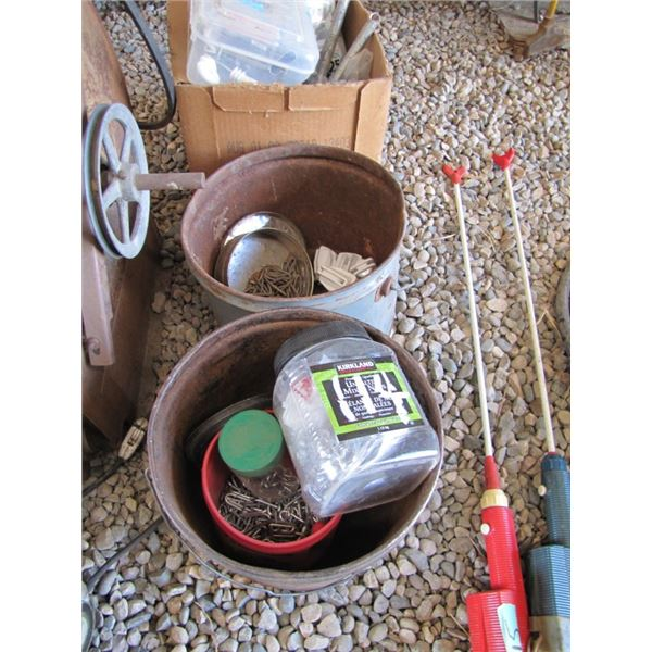 lot of two pails of assorted fencing Staples and the electric fence items & box fencing items