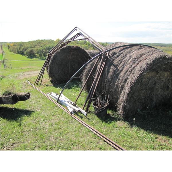 metal frame for building with pegs approximately 23 ft long by 8 ft at Peak