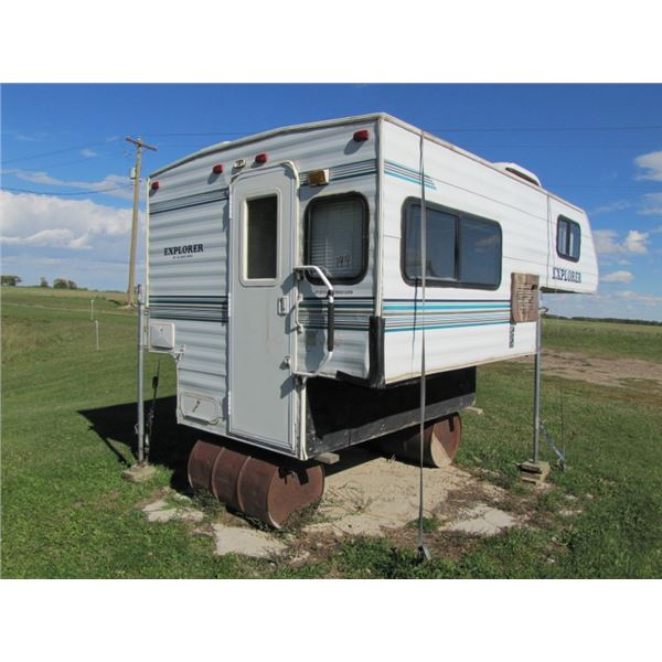 1999 Explorer camper. Sleeps 4. fits 8 foot truck box. Extended Queen. Outdoor shower. Holds two pro