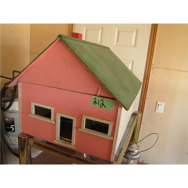 child's wooden dollhouse with furniture
