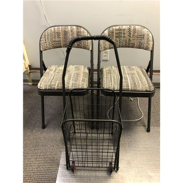 Two folding cushioned chairs & a foldup black metal grocery cart
