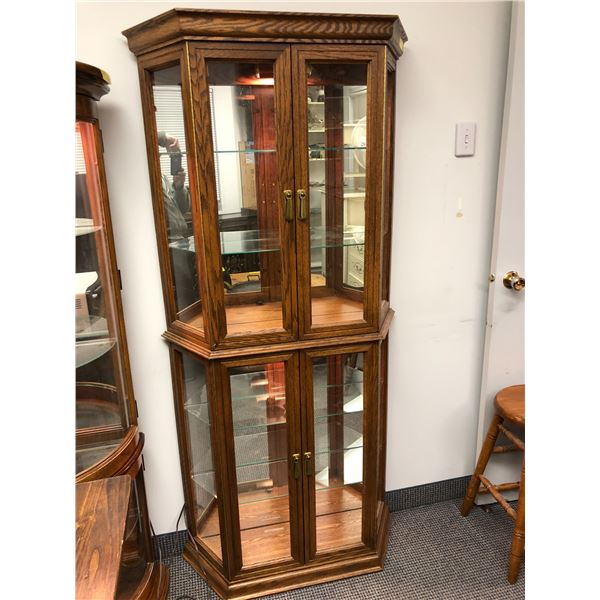 Lighted oak glass front display cabinet