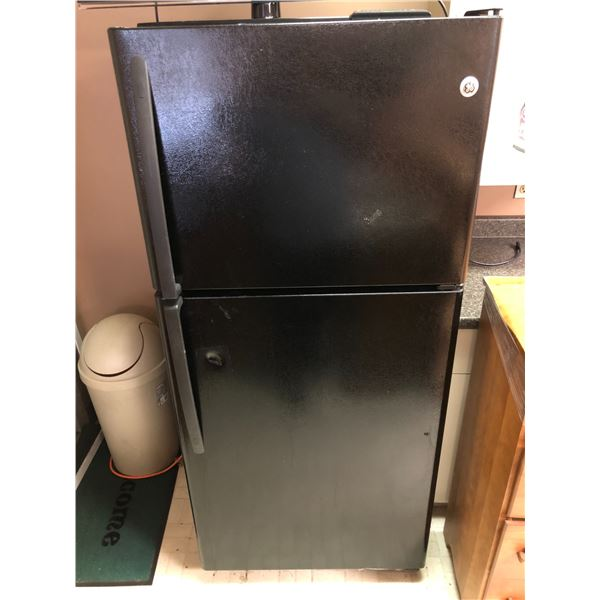 GE 2 door black refrigerator plugged in working condition (small dent present)