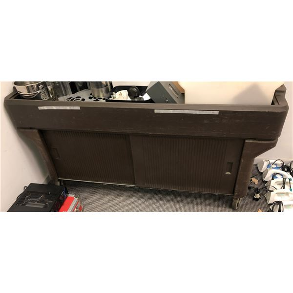 Large brown plastic rolling service cart