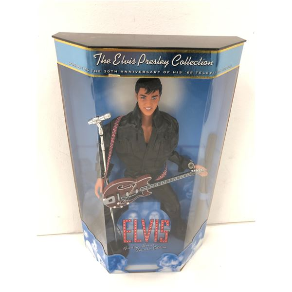 Elvis Presley celebrating the 30th anniversary of his '68 television special collectors' doll in ori