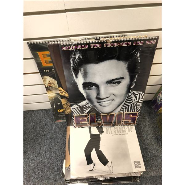 Group of 13 assorted Elvis Presley calendars (still sealed) from 2000's