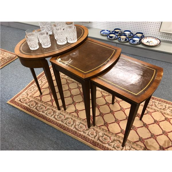 Antique 3 pc. leather top mahogany nesting table set