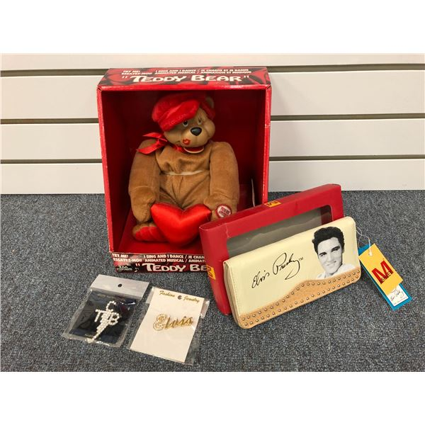 Group of 4 Elvis Presley collectible items - singing teddy bear/ ladies pocket book & 2 Fashion Jewe