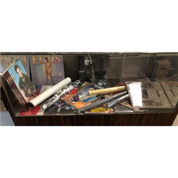 Showcase full of assorted Elvis Presley memorabilia - mostly calendars & posters