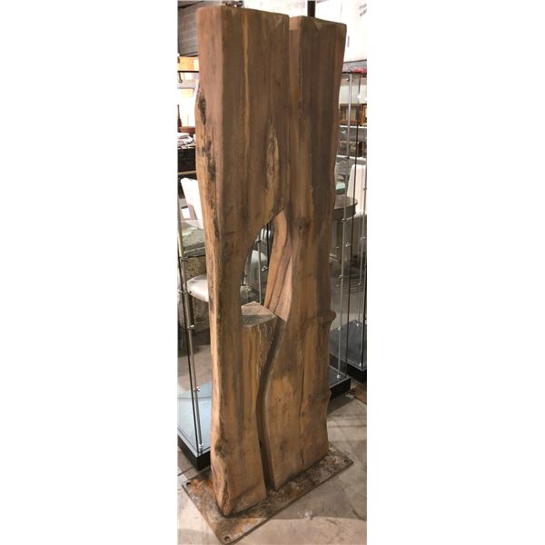 Large wooden sculpture on solid steel plate - approx. 6 1/2ft tall x 2ft wide from the show