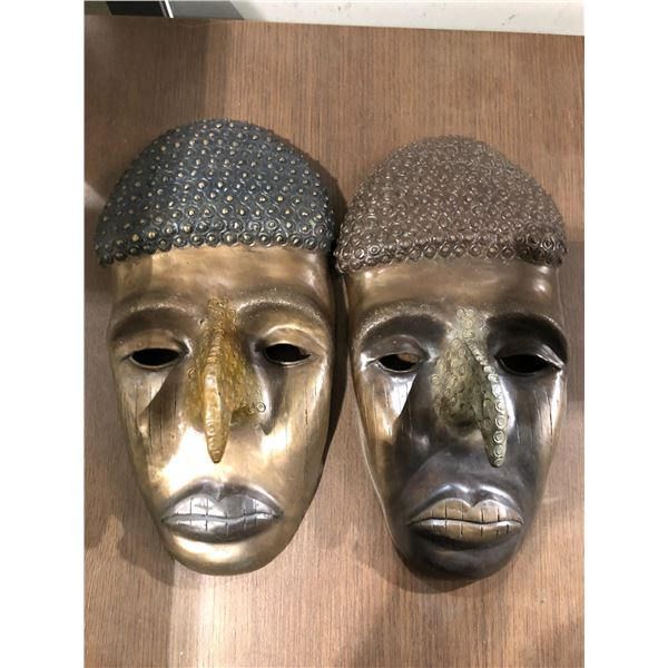 Pair of solid brass hooked nose Aboriginal decorative wall hangings