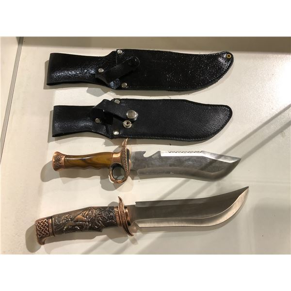 Two hunting/ fighting style knives w/ black leather sheath