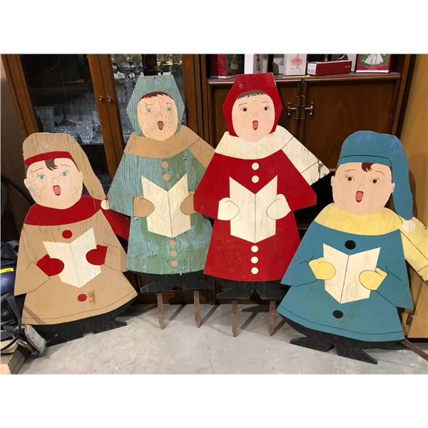 Group of 4 plywood cut-out Christmas carolers front yard decorative ornaments - each caroler approx.
