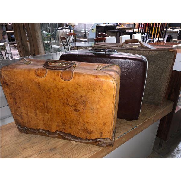 Three vintage suitcases
