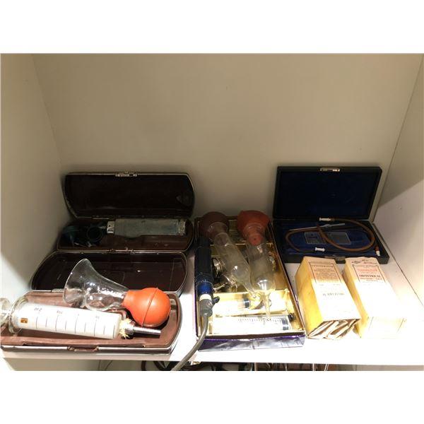 Shelf lot of vintage doctors equipment & instruments