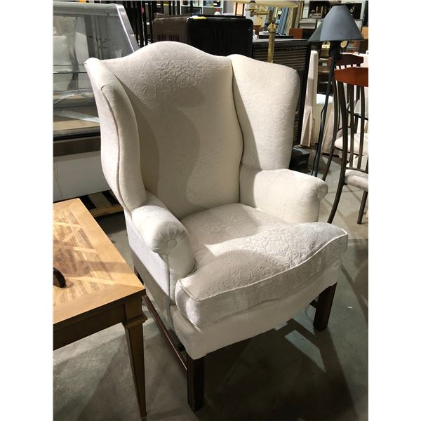 White upholstered wing back chair
