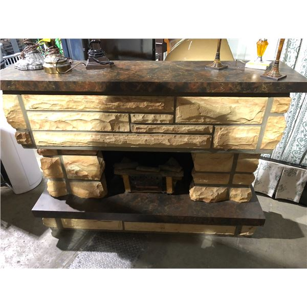 Faux stone fireplace mantle w/ electric fireplace inset from the show