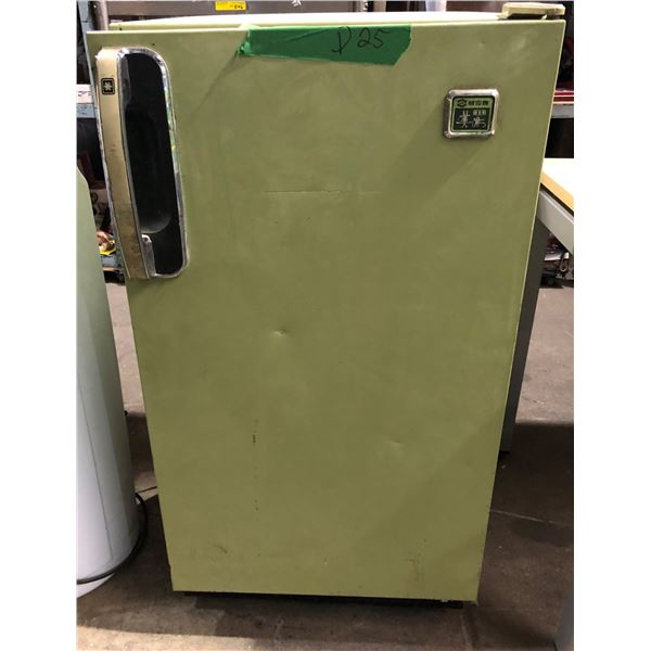 Vintage green compact fridge Made in Japan from the show