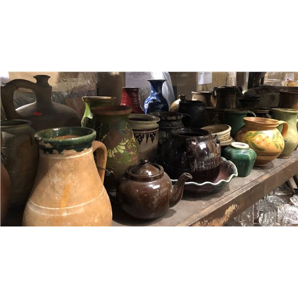 Large shelf full of assorted ceramic pottery pcs.