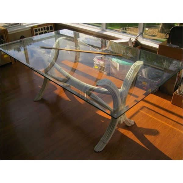 GLASS TOPPED RATTAN BASED DINING TABLE