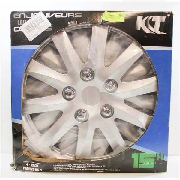 """FOUR PACK 15"""" WHEEL COVERS MINT IN BOX"""
