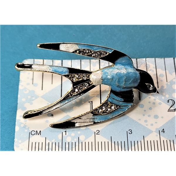 9) BLACK, WHITE AND BLUE ENAMEL WITH CLEAR
