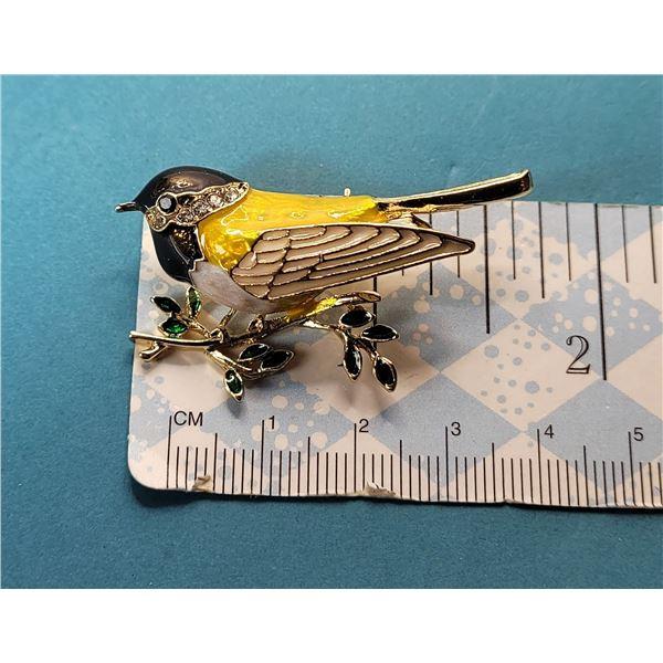 2) GOLD TONE AND ENAMEL BIRD BROOCH ON
