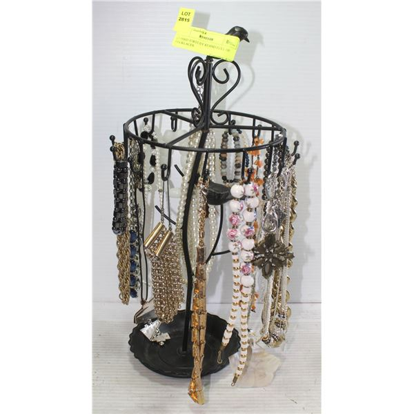 BIRD JEWELRY STAND FULL OF NECKLACES