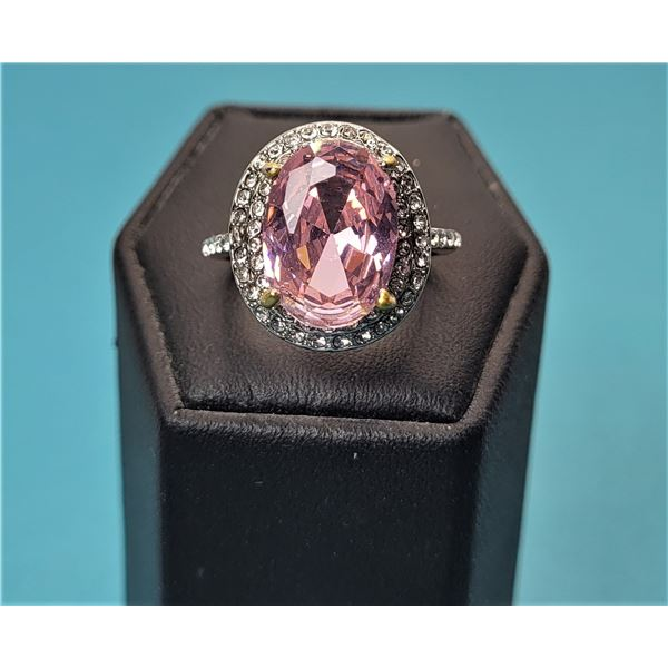 15)  LAB CREATED PINK OVAL SAPPHIRE HALO