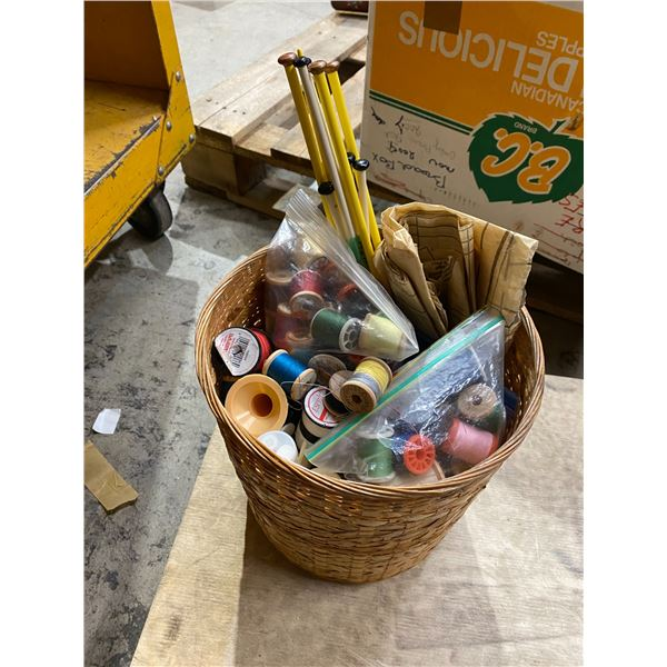 Threads and knitting needles in basket