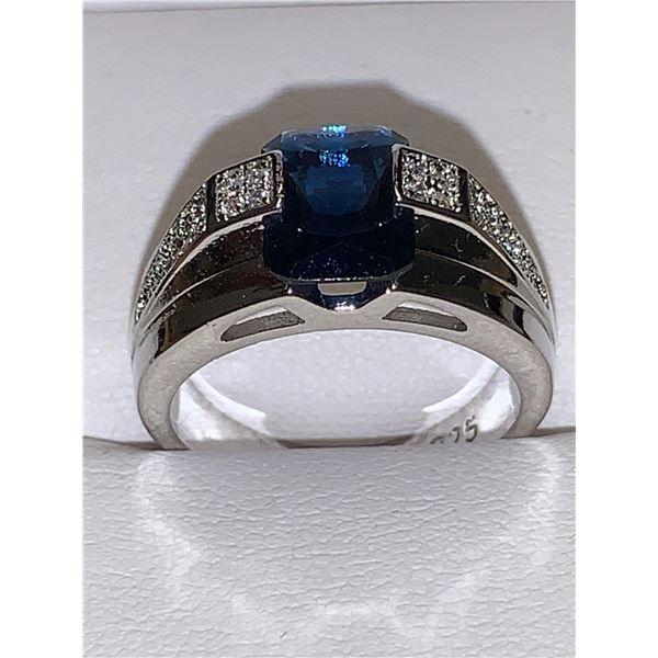 Ladies Emerlad Cut blue topaz solitaire .925 stampedRing