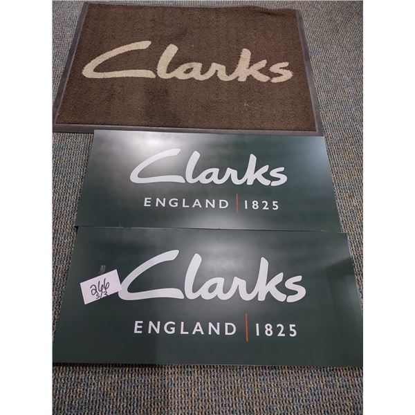 PAIR OF CLARKS NEW METAL SIGNS, W/ MAT (USED)
