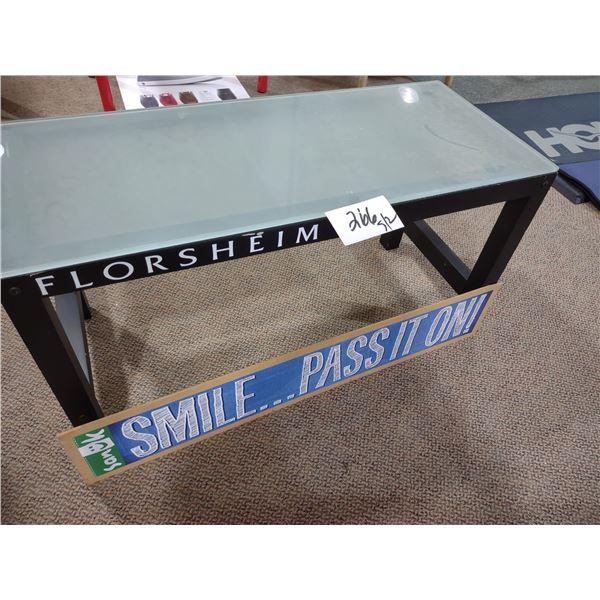 FLORSHEIM GLASS/METAL DISPLAY TABLE, W/ SANUK SMILE SIGN